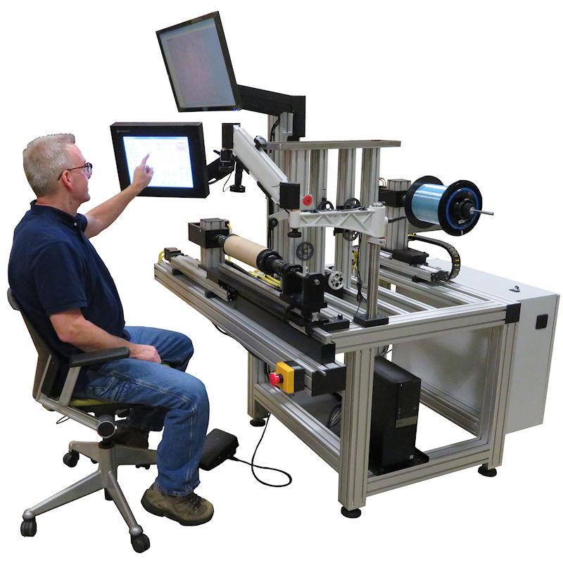 The ErgoSpooler is a precision winding machine for applications where interaction or monitoring by an operator is required. It is ergonomically designed with the take-up spool and operator interface within easy reach of the user. The moving take-up and payoff design produce neat and even layers of material onto a spool or mandrel.